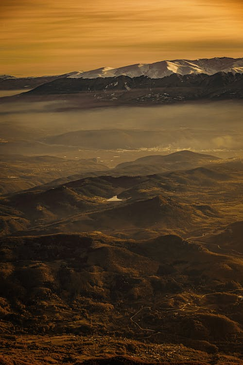 Aerial Photography of Mountain Under Orange Sky