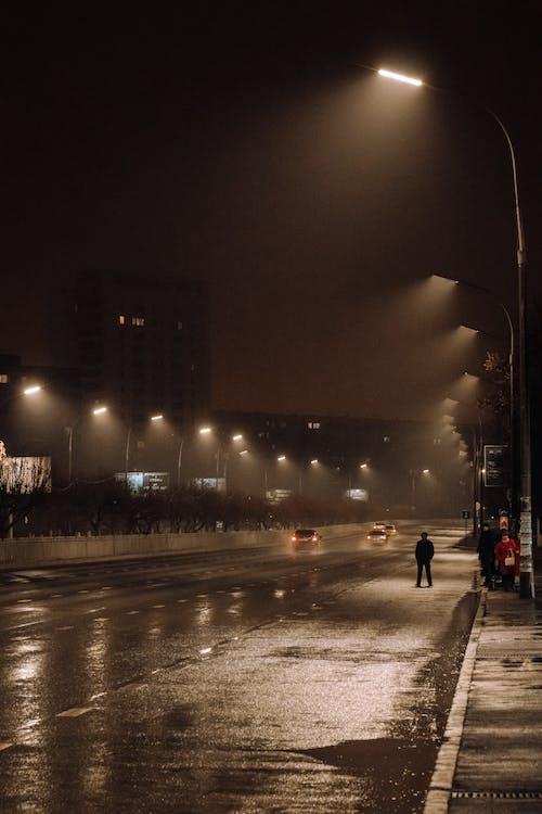 Gratis lagerfoto af aften, gade, gadelygter