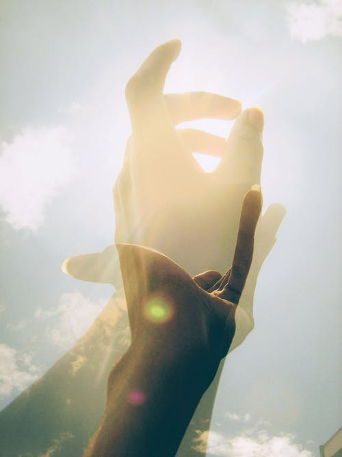 Free stock photo of double exposure of hand in the sun