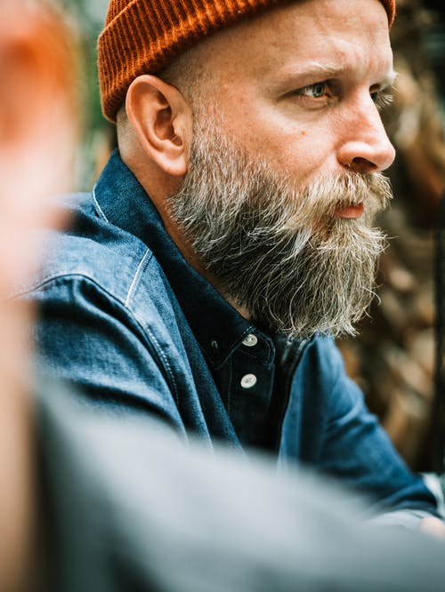 Shallow Focus Photo Of A Man's Profile With A Beard And Mustache Wearing A Beanie
