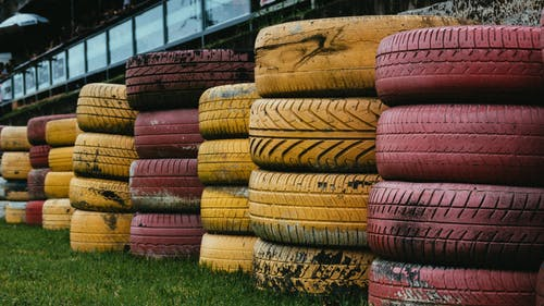 Pile of Yellow And Red Vehicle Tires