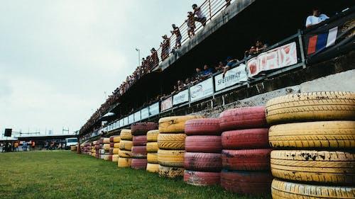 People in a  RaceTrack