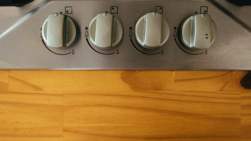 Control Knobs Near Wooden Plank