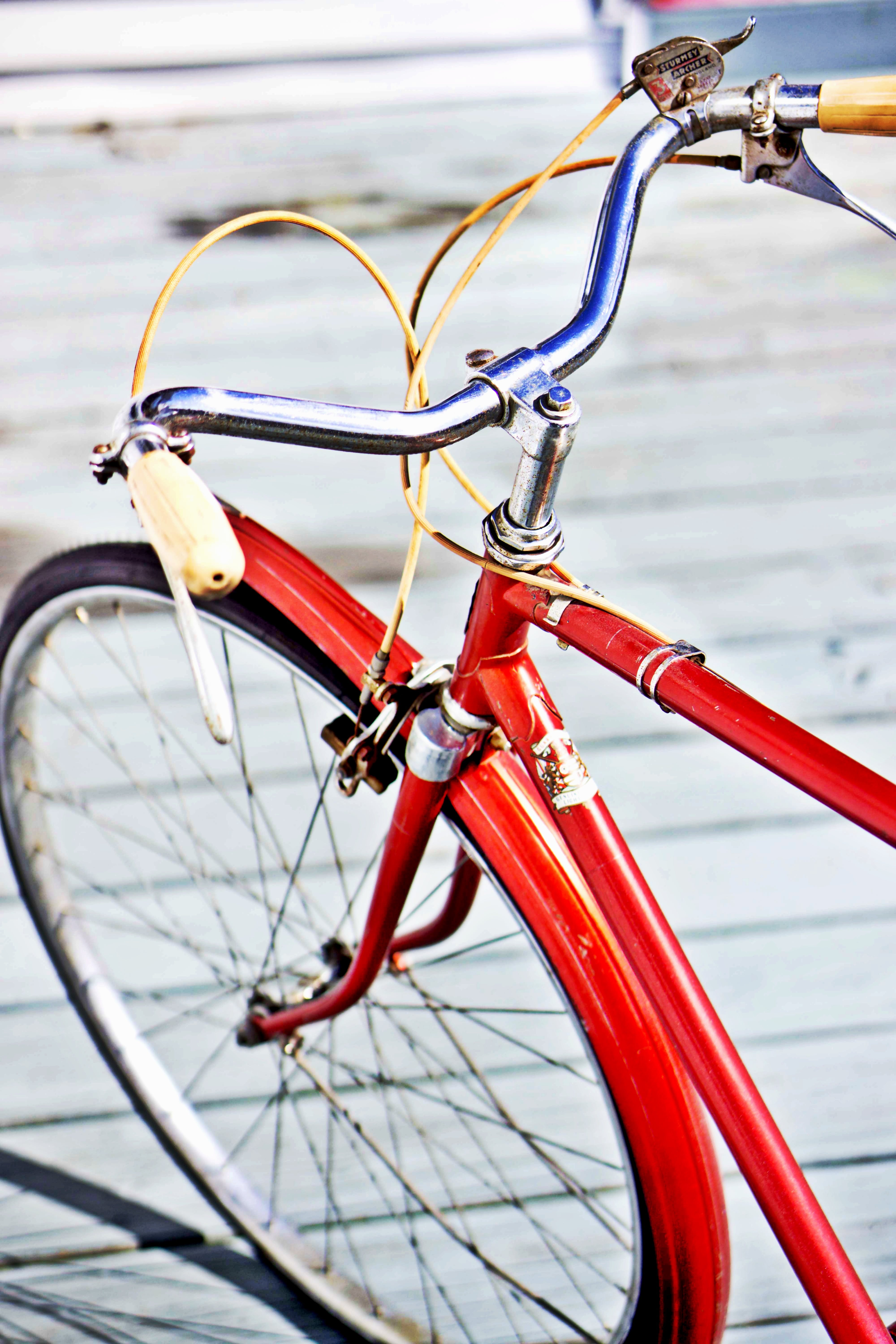 Selective Focus Photograph of Red Rigid Bicycle