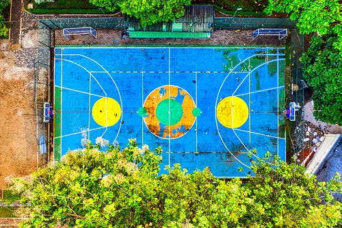Aerial Photography of Blue and Yellow Basketball Court