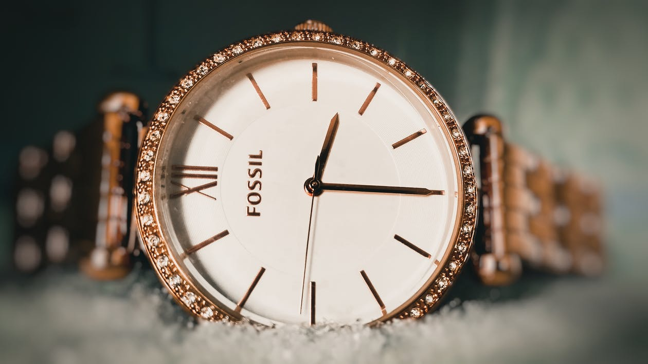 Round Gold-colored Fossil Analog Watch