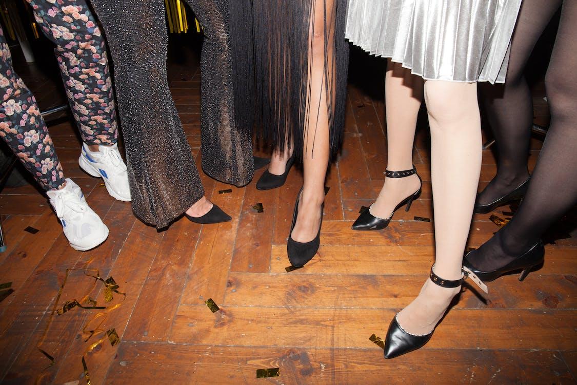 Women Wearing Black High Heels