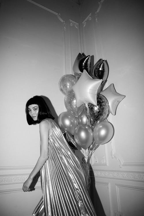 Woman Posing Near Balloons