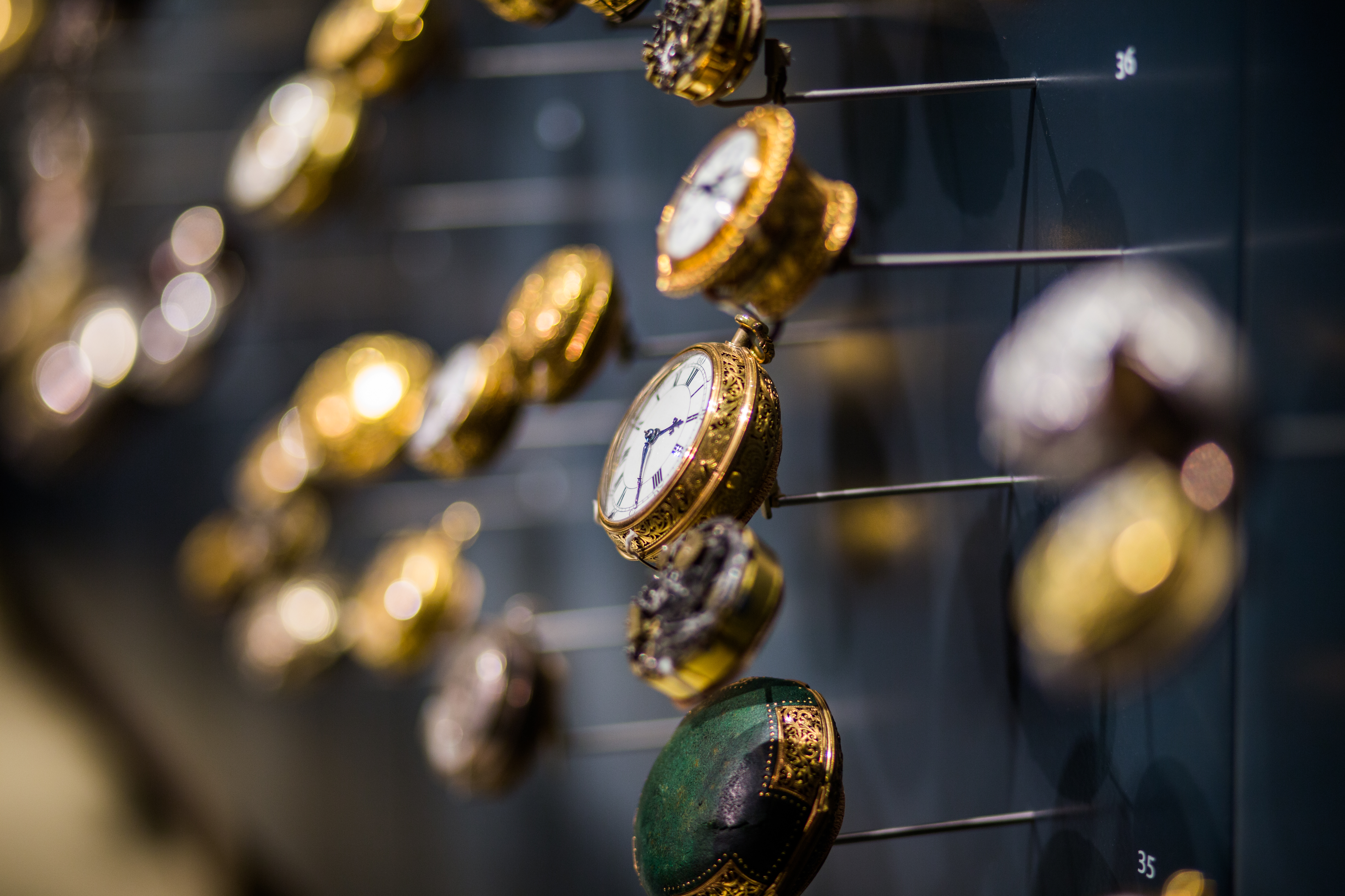Gold-colored Nalog Watches on Selective Focus Photo