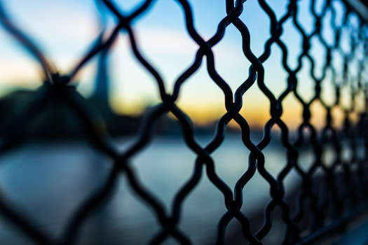 Close Photography and Tilt Lens of Black Chain Link Fence