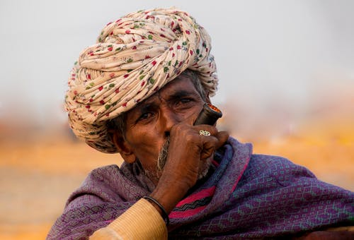 Photo Of An Old Man Smoking Pipe