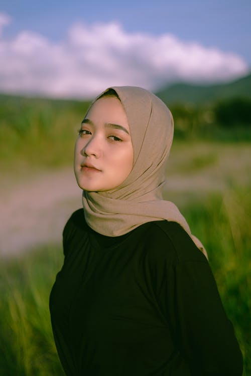 Shallow Focus Photography of Woman Wearing Gray Hijab