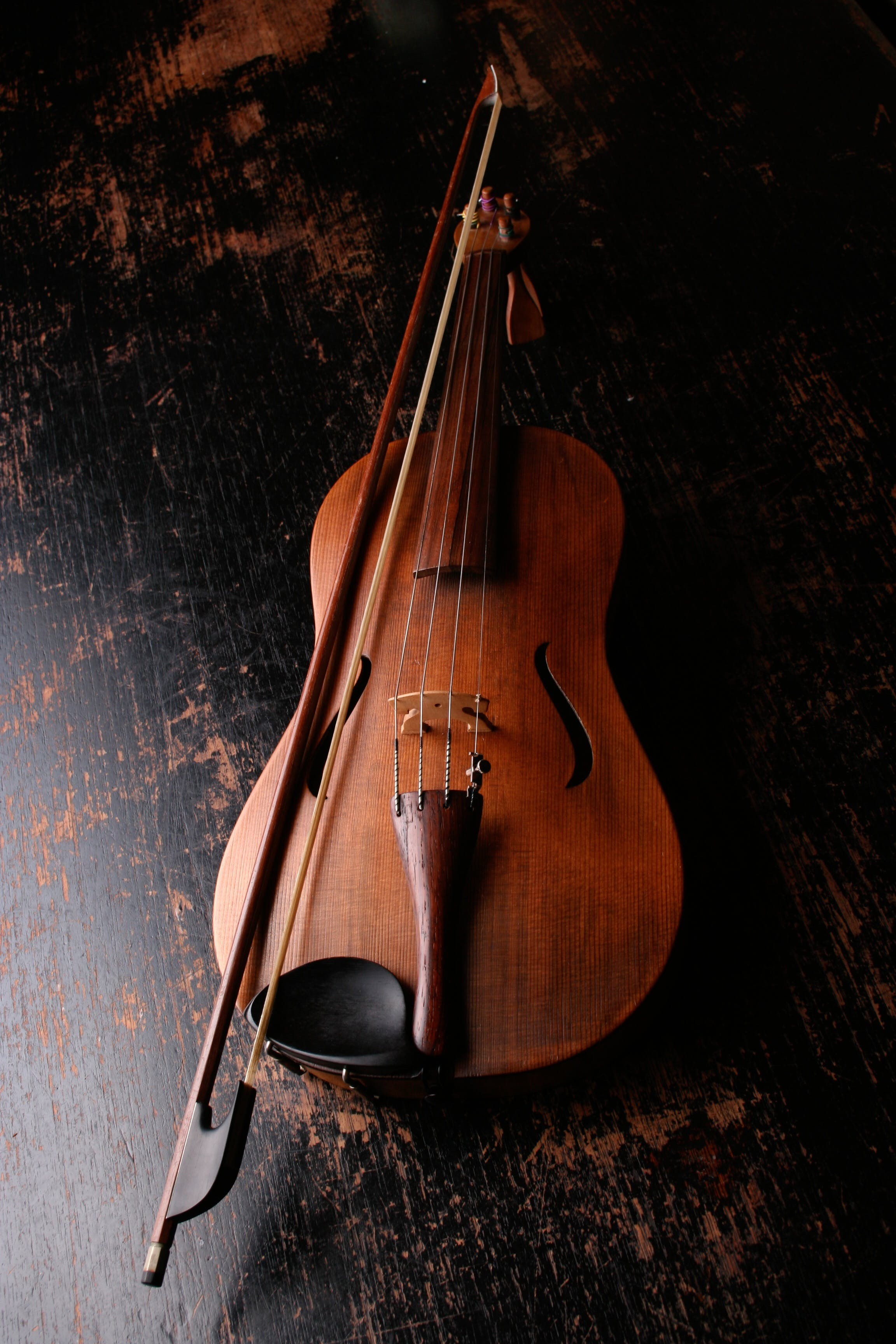 Brown Wooden Violin and Violin Bow