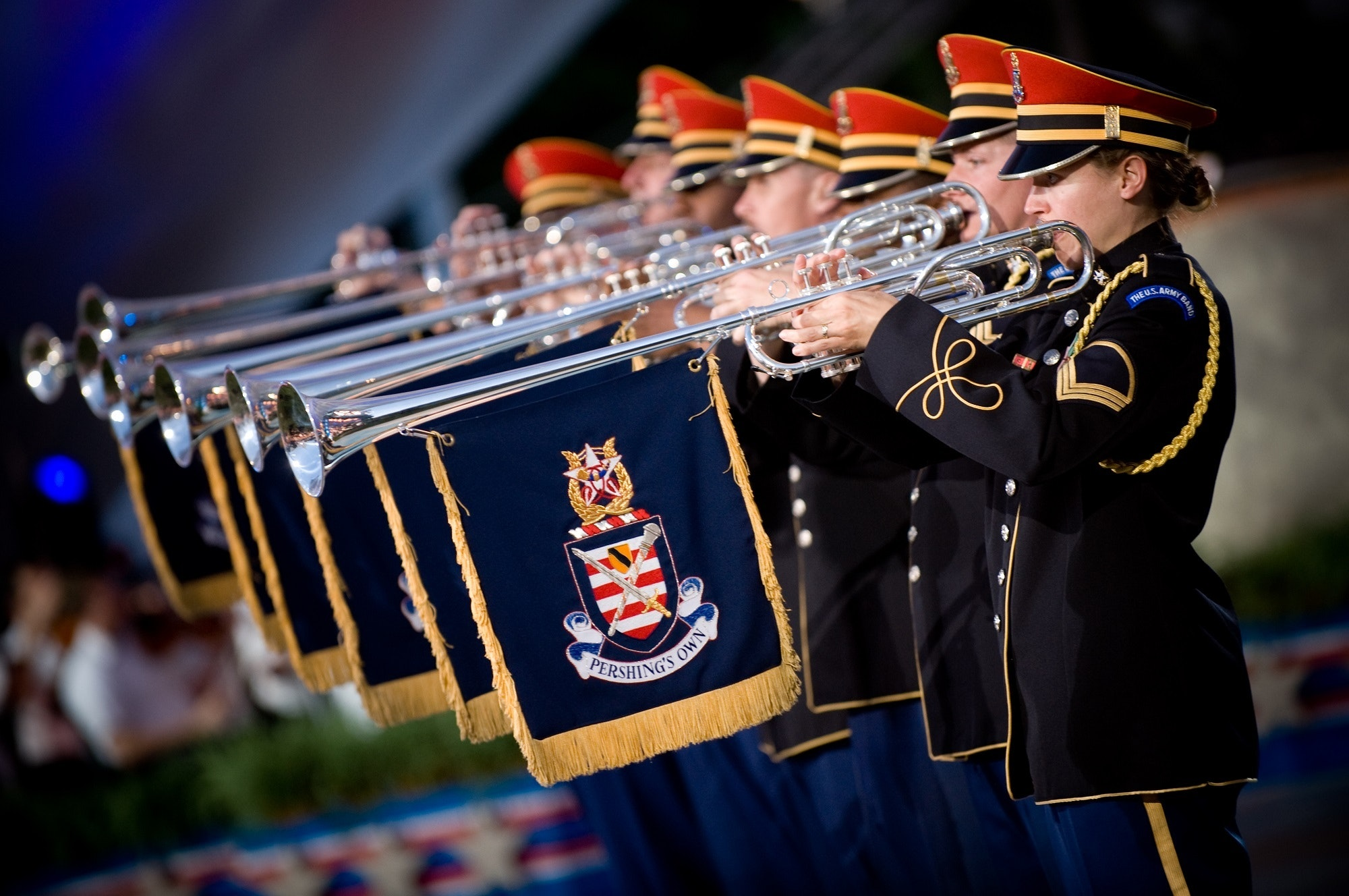 People in Uniform Using a Trumpet Instrument With Blue and Yellow