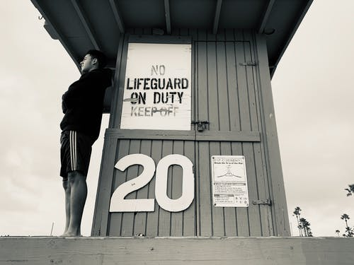 Man Standing on the Life Guard House