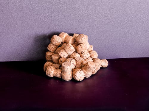 Free stock photo of corks, light and shadow, light reflection, purple background