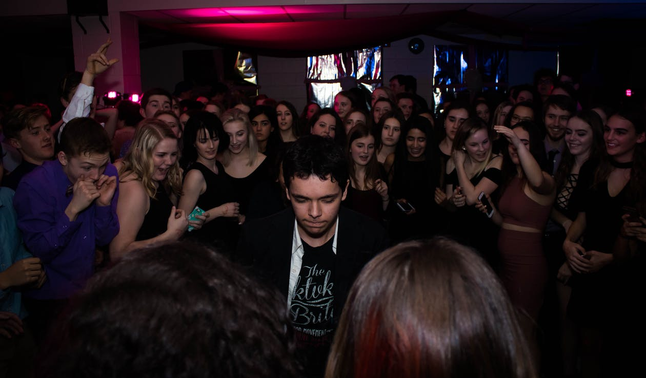 Man Standing in the Center of Crowd