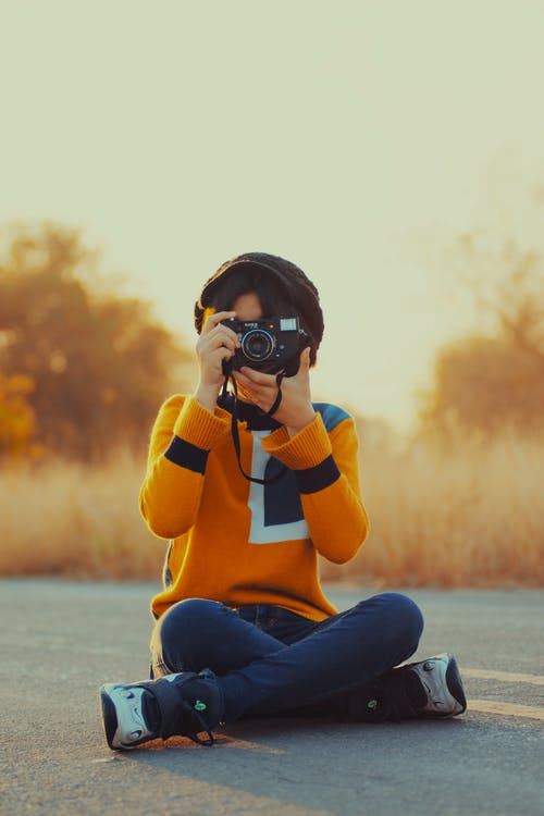 Person Taking Photo Using Camera