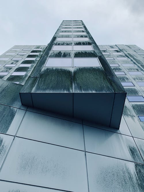 Low Angle Photography of Green High-rise Building