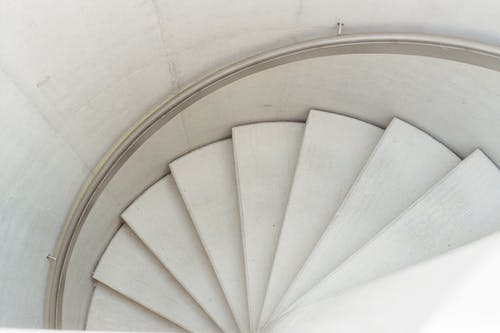 High Angle Photo of White Spiral Staircase