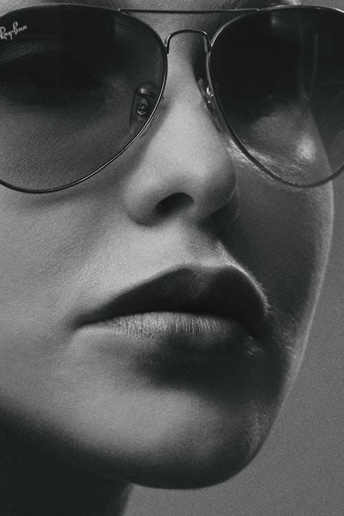 Grayscale Photo of Woman Wearing Aviator Sunglasses