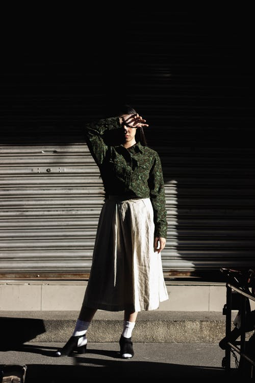 Woman in Green Long-sleeved Shirt and Brown Skirt
