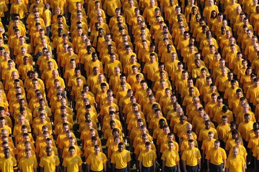 A line-up of people all in yellow to signify community