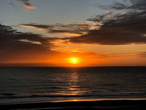 Ingyenes stockfotó amanhecer, nap, praia, sol témában