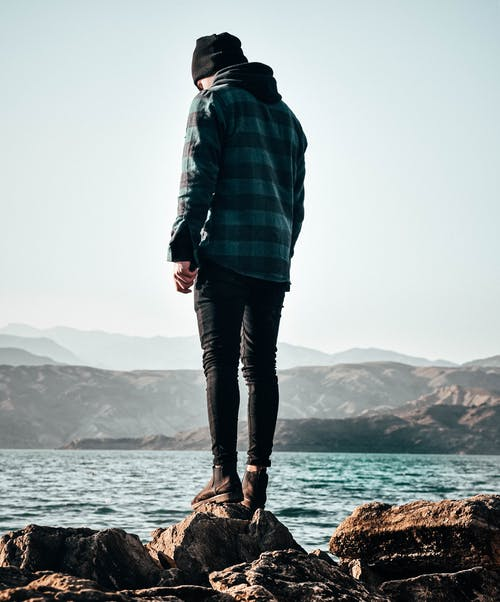 Photo of Person Wearing Blue and Black Plaid Hoodie