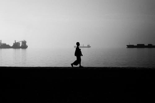 Silhouette Photo of Person Walking