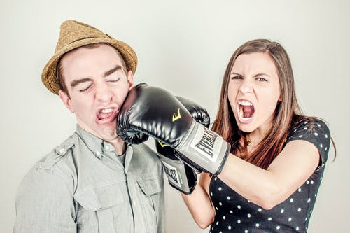 Woman Punching Men's Face