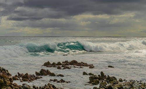 Free stock photo of beach waves, dark clouds, glistening, indian ocean