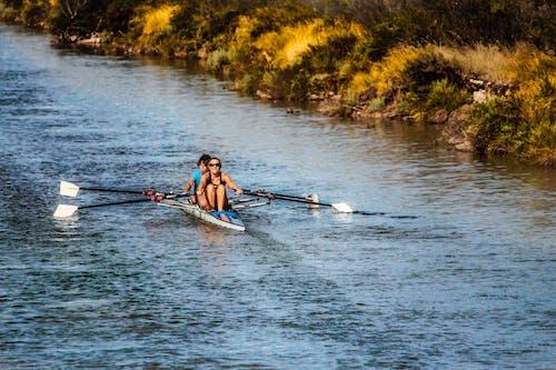 Δωρεάν στοκ φωτογραφιών με άθλημα, ανάχωμα, βάρκα με κουπιά, γυναίκες