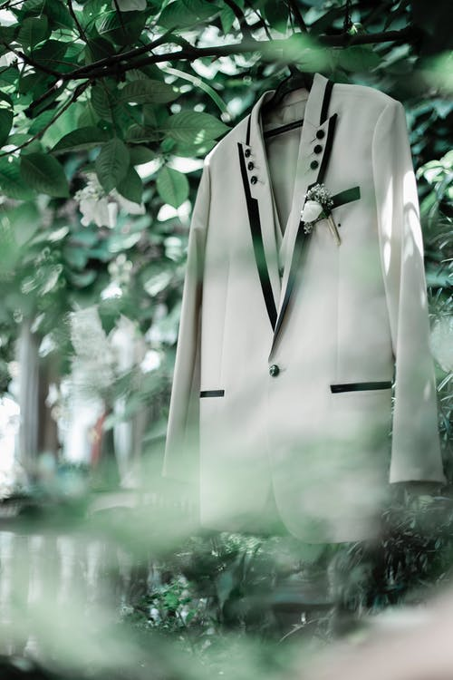 Hanging White Suit on Tree