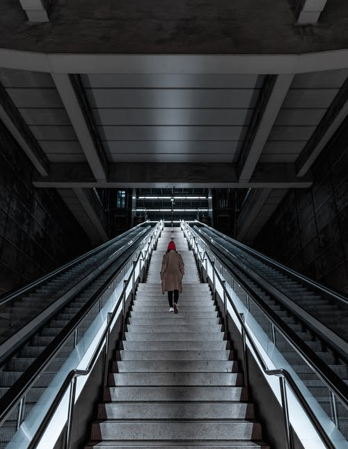 Photo of Person Climbing Stairs