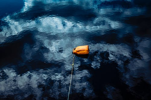Brown Container Floating on Water