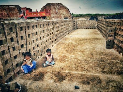 Free stock photo of boy, brick, children, poverty