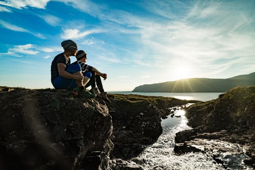 Two Man Sitting on Cliff