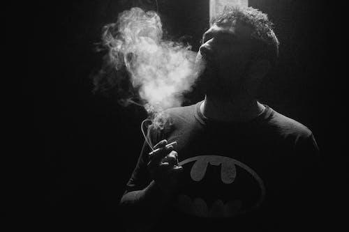 Free stock photo of batman, cigarrillo, contraluz