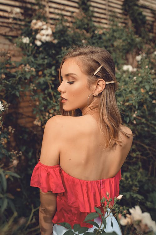 Shallow Focus Photo of Woman Wearing Red Tube Top