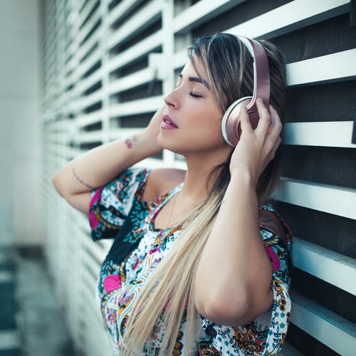 Photo Of Woman Using Headphones