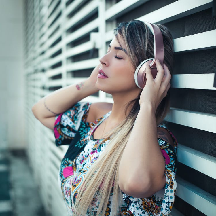 Photo Of Woman Using Headphones