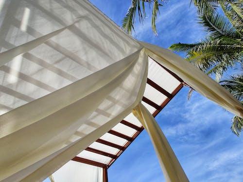 Stylish wooden resort pavilion on sunny day