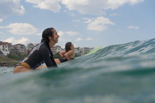Photo Of Women Riding Surfboard