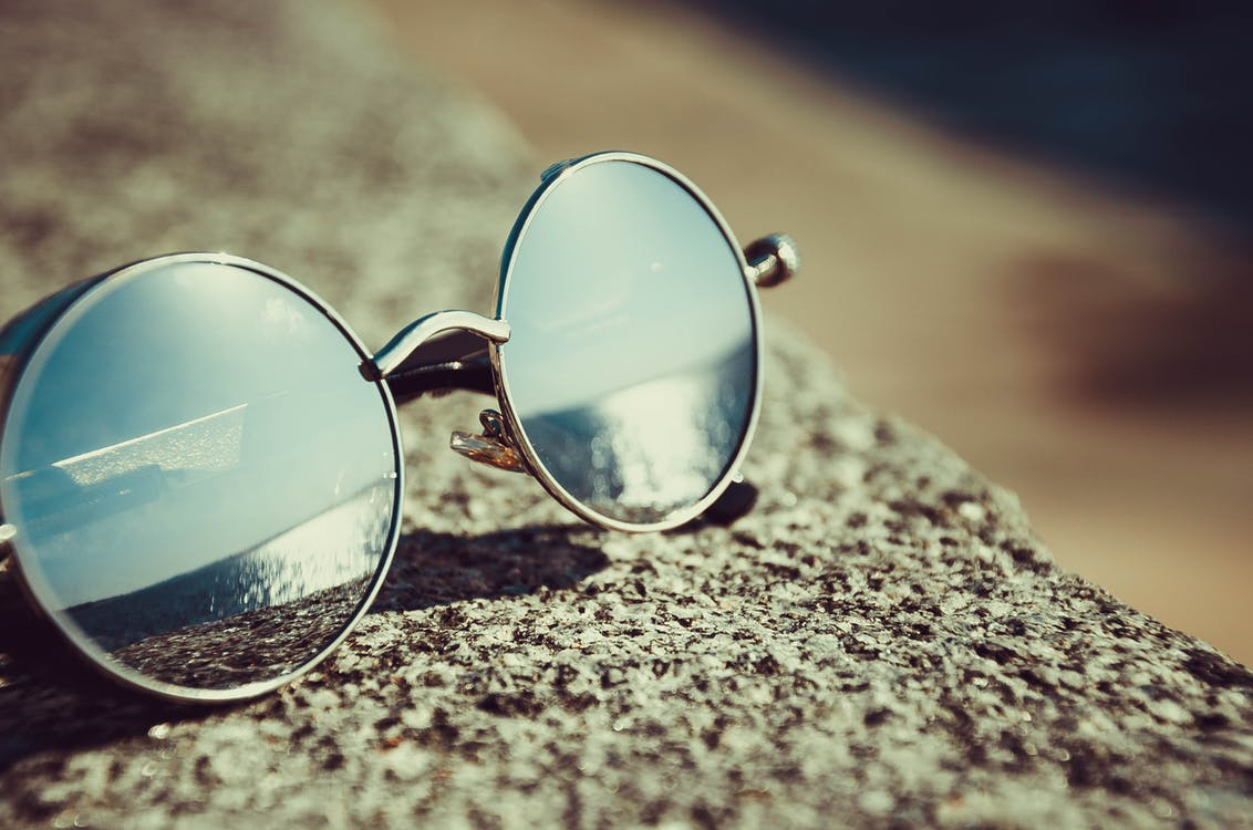 df5a88bb5f7 Silver Framed Hippie Sunglasses on Concrete · Free Stock Photo