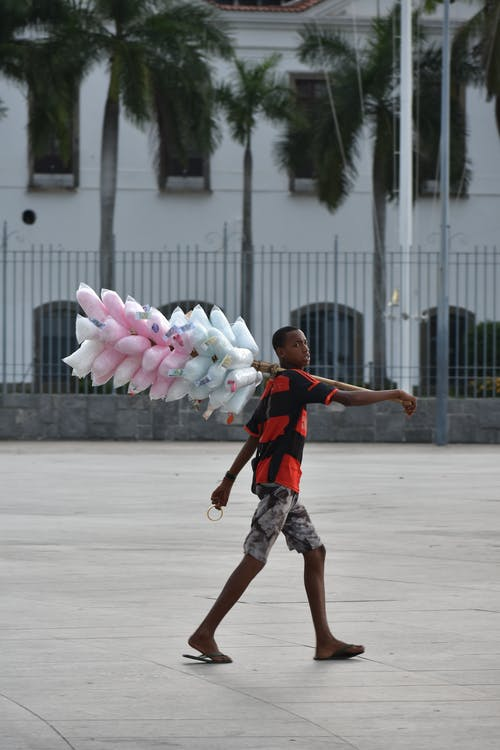 Photo Of Man Carrying Cotton Candies