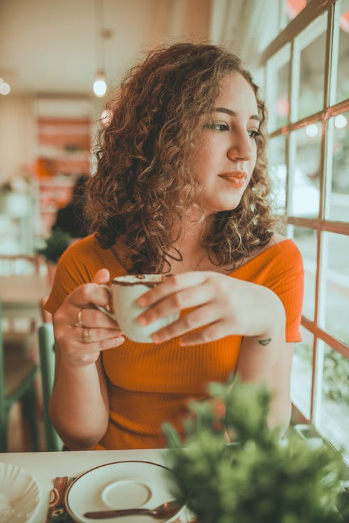 Photo of Woman Holding Cup