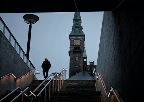 Photo Of A Man Going Down The Stair
