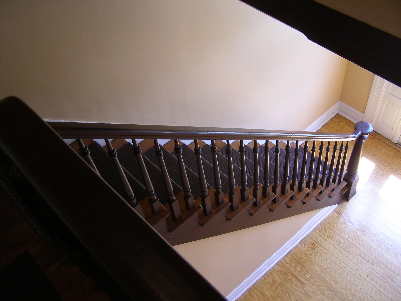 Brown Wooden Stairs in Front of White Wooden Door