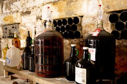 Free stock photo of bottles, jugs, stone wall, wine
